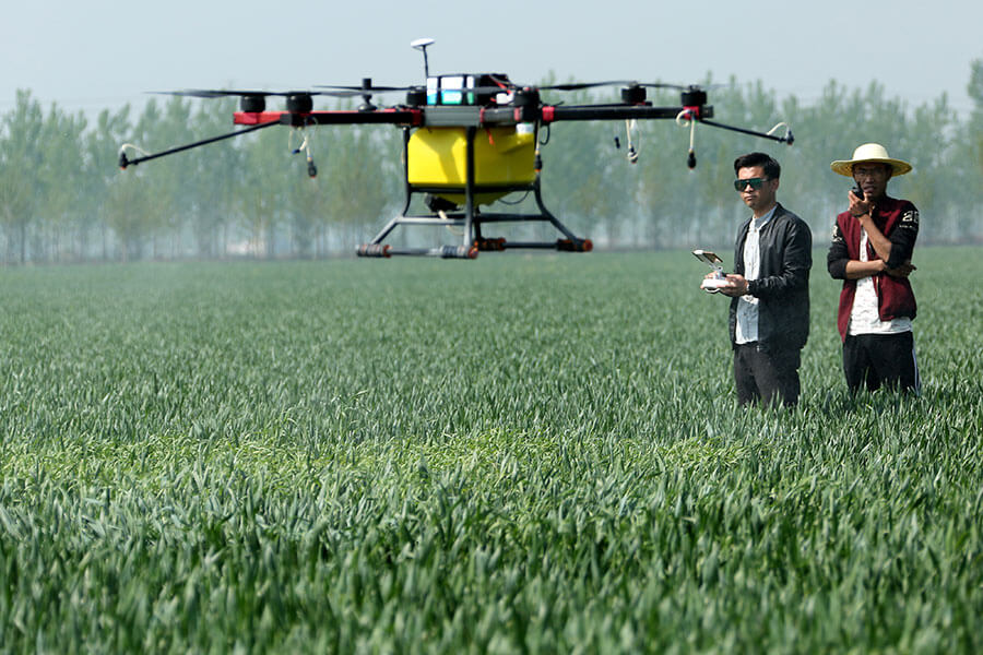 Agriculture Drone Fertilizing the Field